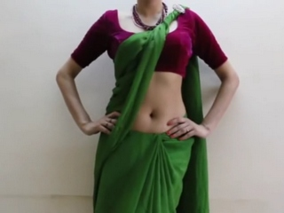 Spy vid 52. Exciting indian wife in saree doing a strip navel show